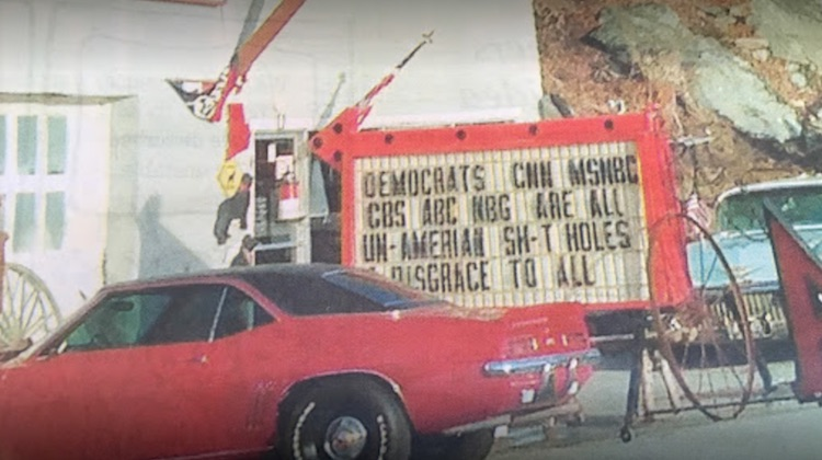 The Hog Ring - Trim Shop Sparks Outrage with Political Sign 2